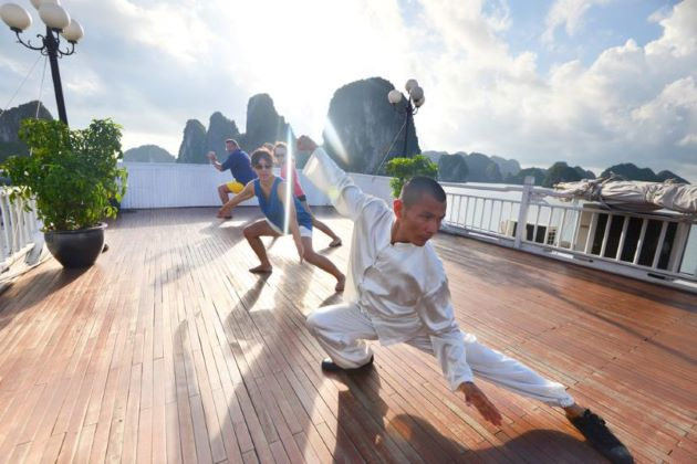tai chi exercise in halong bay