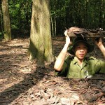 A soldier shows the way to get in and get out the tunnel of Cu Chi