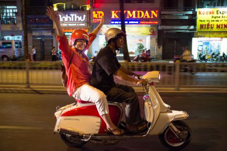 Discover Ho Chi Minh Nighlife on the back of scooter